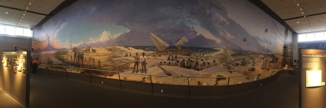 mural running from dinosaurs through 1900s human history (L-R)