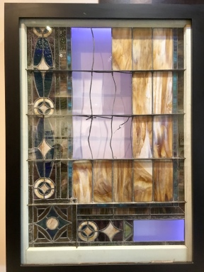 """""""This original window from the balcony of the 16th Street Church was not damaged in the bombing. The missing panes were removed to repair other windows."""""""