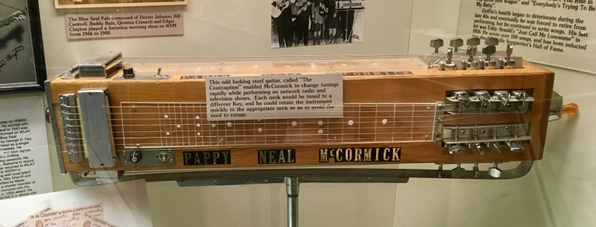 """This odd looking steel guitar, called 'The Contraption,' enabled Pappy Neal McCormick to change tunings rapidly while performing on network radio and television shows. Each neck would be tuned to a different key, and he could rotate the instrument quickly to the appropriate neck so as to avoid the need to retune."""