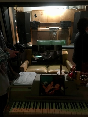 foreground to back: Wurlitzer; Rod Stewart photo; control room