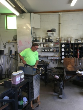 Ron Hinkle blowing glass